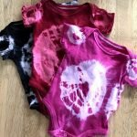 baby clothes and onesies with tie dye pattern